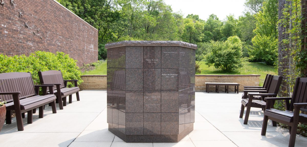 An Antioch columbarium sits in the center of a church's outdoor courtyard.