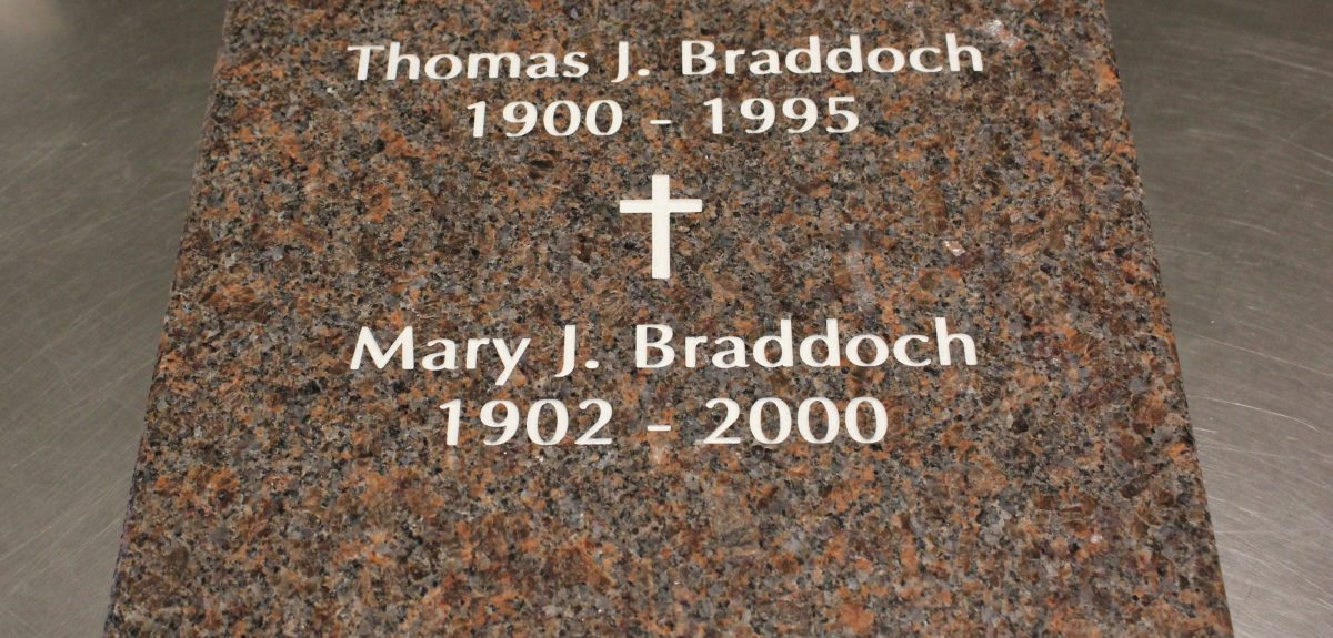 niche front example inscription with cross - mahogany granite