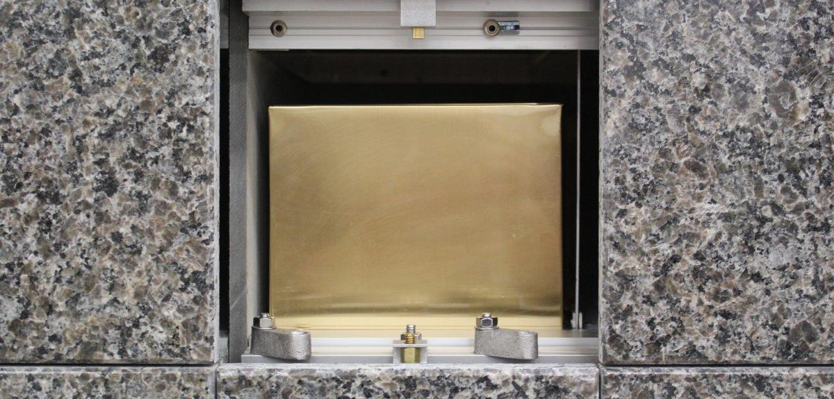 sheet bronze urn in columbarium niche