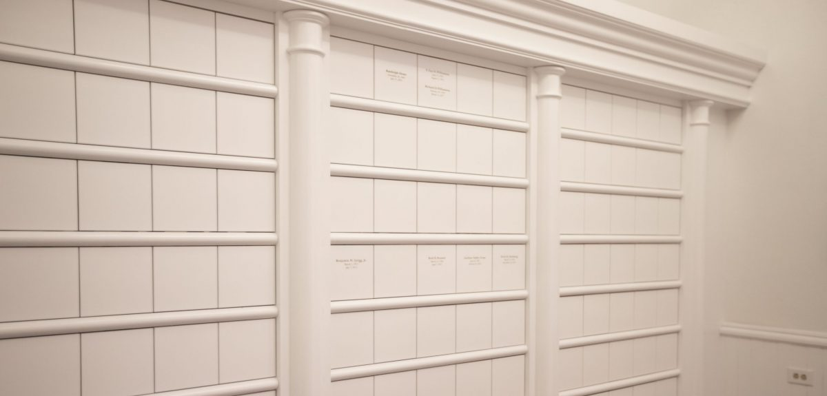 Rows of niches are separated by rounded protruding trim pieces.