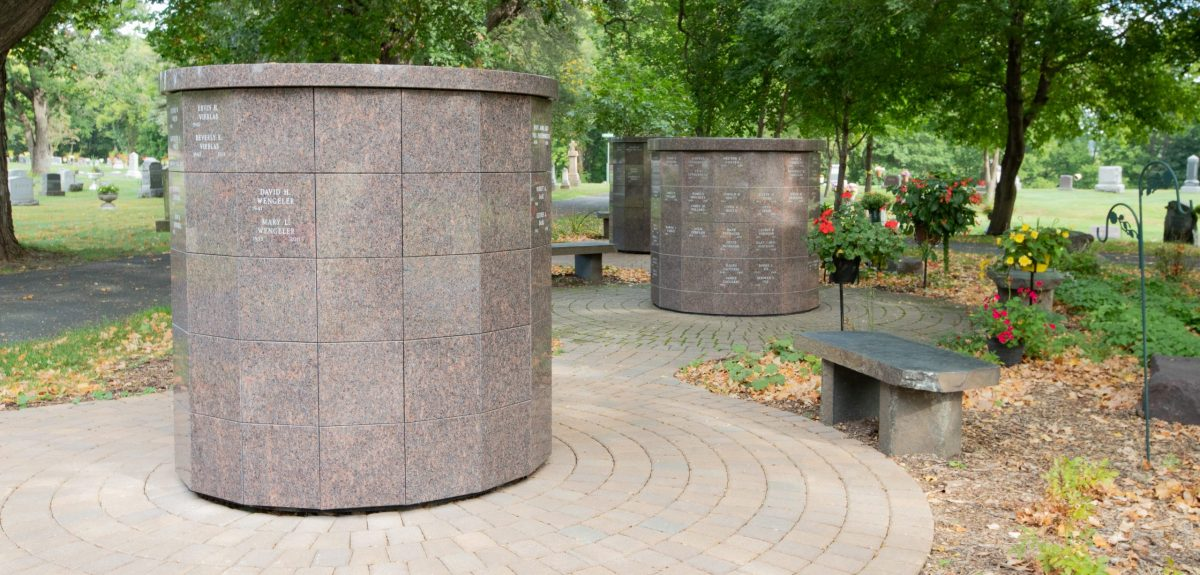 A Winchester columbarium sits in the foreground with two Winchester columbaria behind it adorned with multiple flower pots.