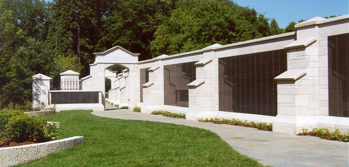 Ornate stone masonry encapsulates multiple columbarium cabinets.